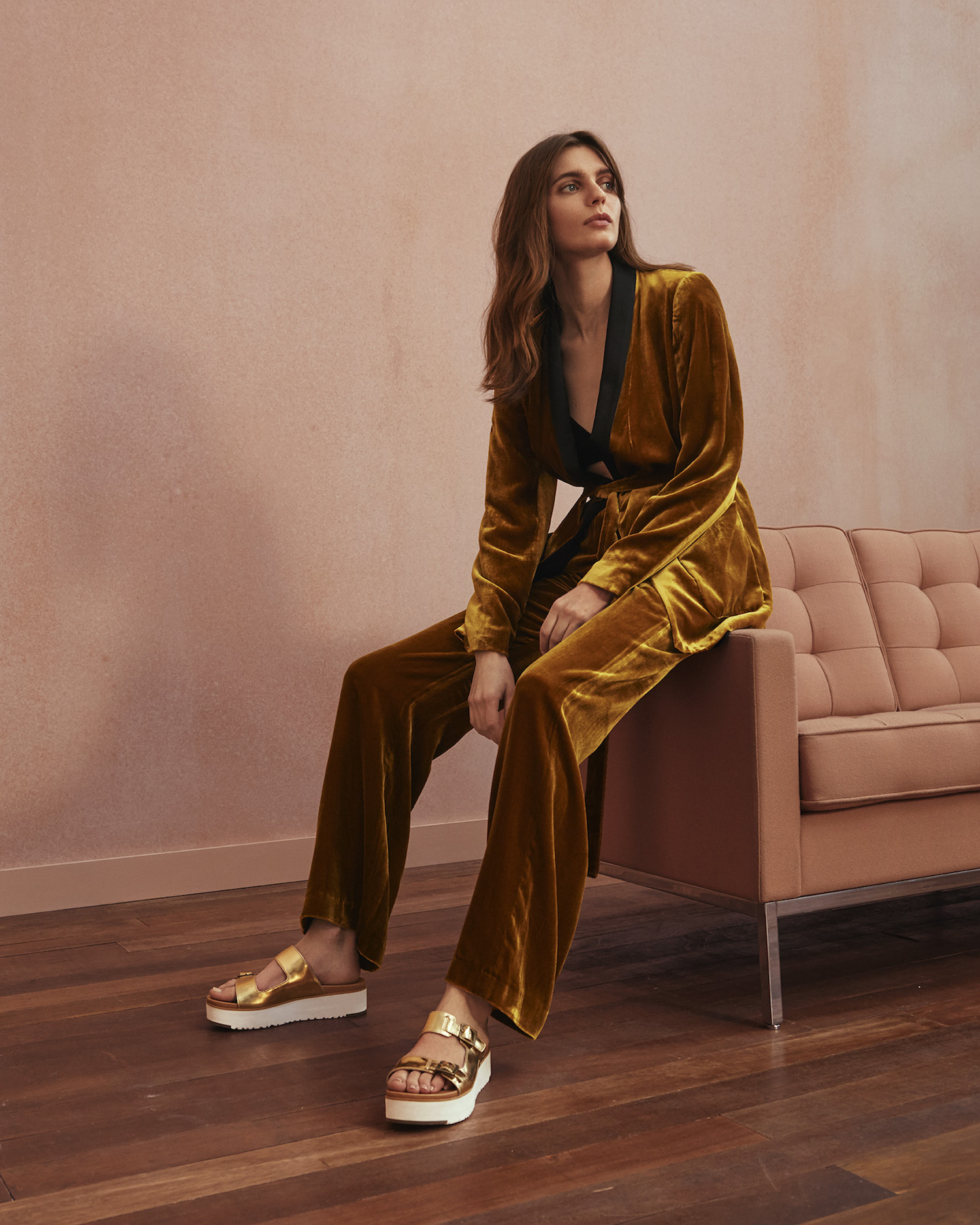 Model wearing velour pajama suit and the gold Ardyne flatform sandals