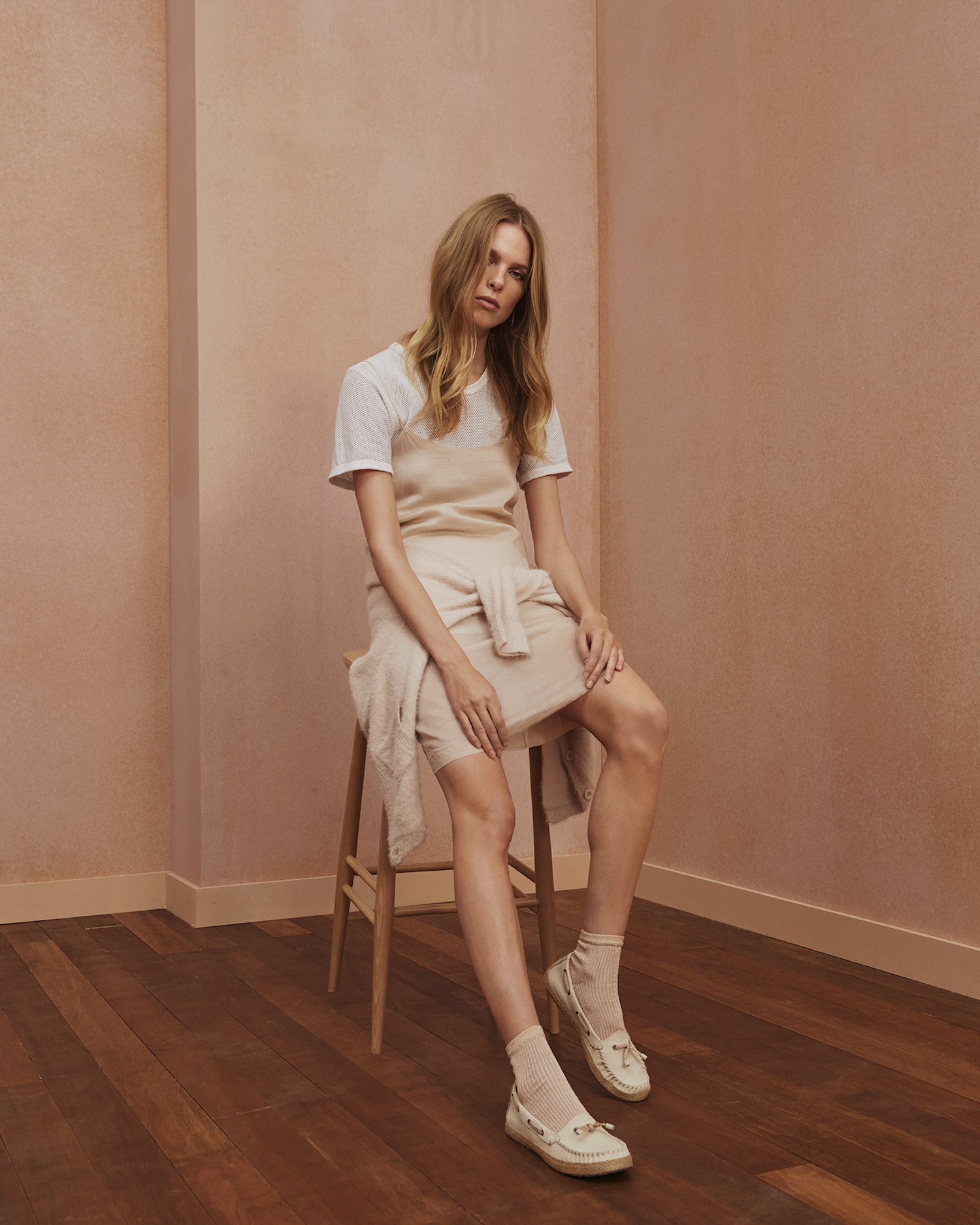 Model wearing a tee, slip dress, socks, and the Chivon moccasin