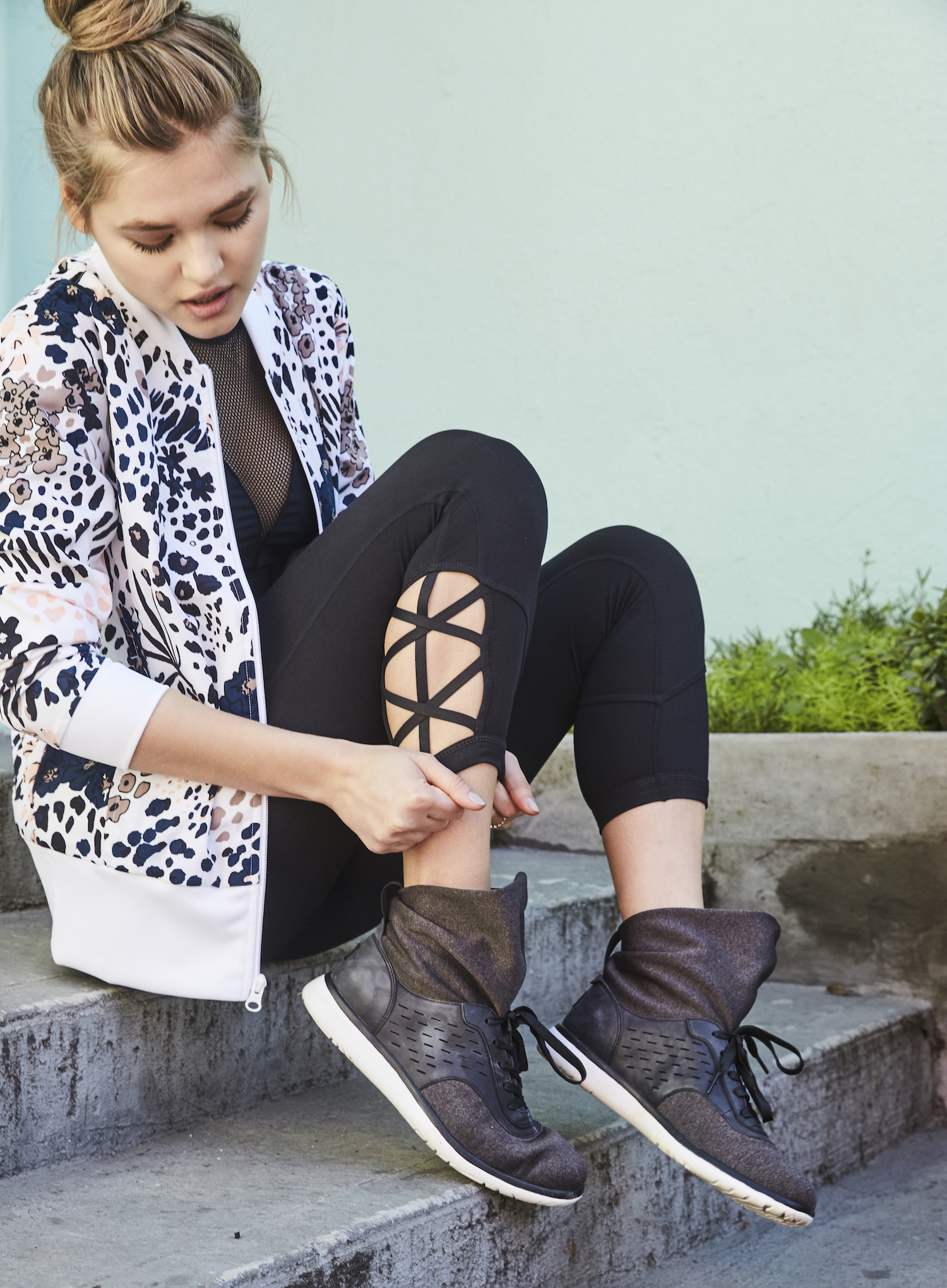 Here the Islay is worn with black leggings, a mesh sports bra, and floral print jacket.
