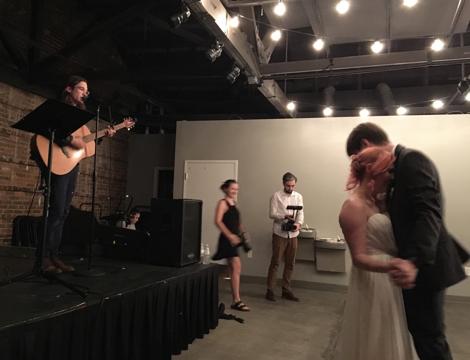 Chris Farren surprises a groom at his wedding with a performance, and the couple dances.