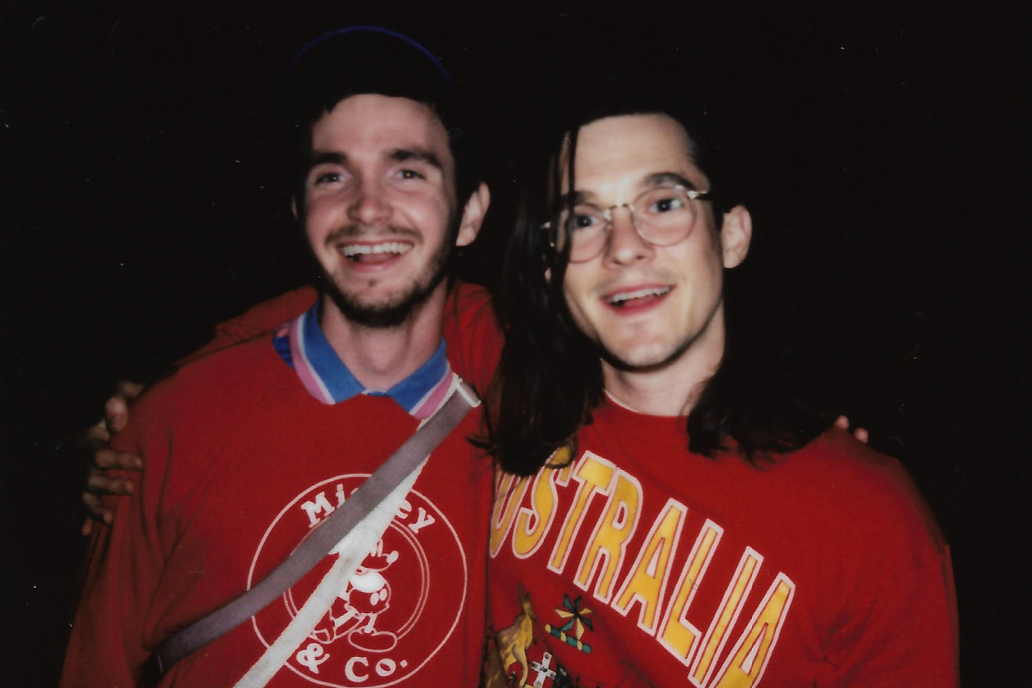 Chris Farren smiles with Tyler Broderick of Diners, who wears a Micky Mouse sweatshirt gifted to him by Chris.