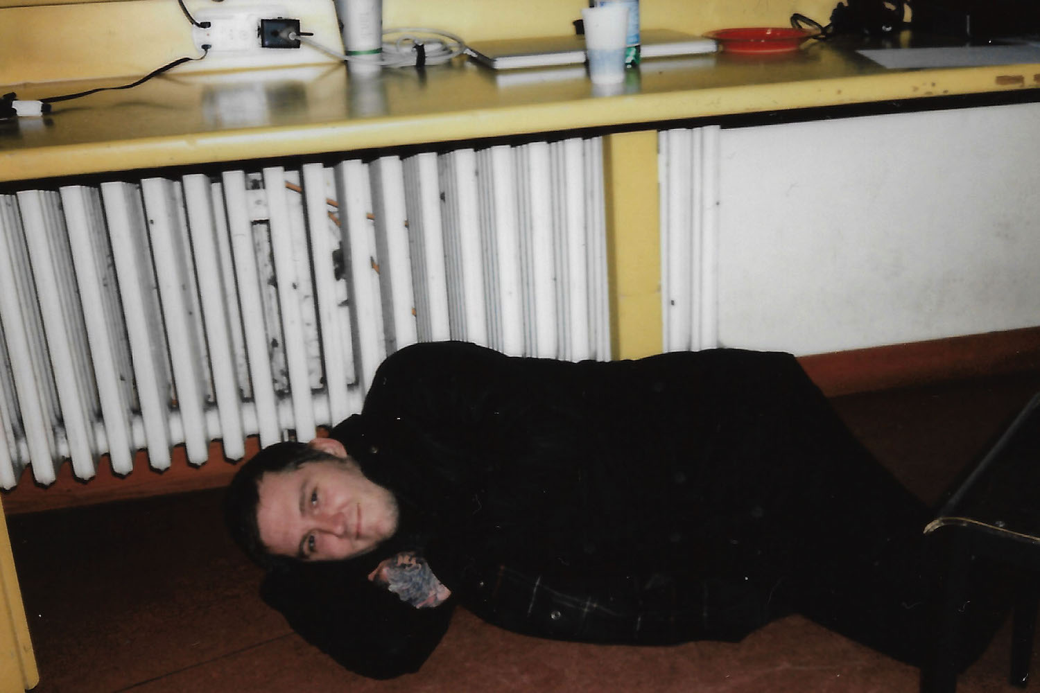 Gaslight Anthem's Brian Fallon curls up on the floor next to the heater.
