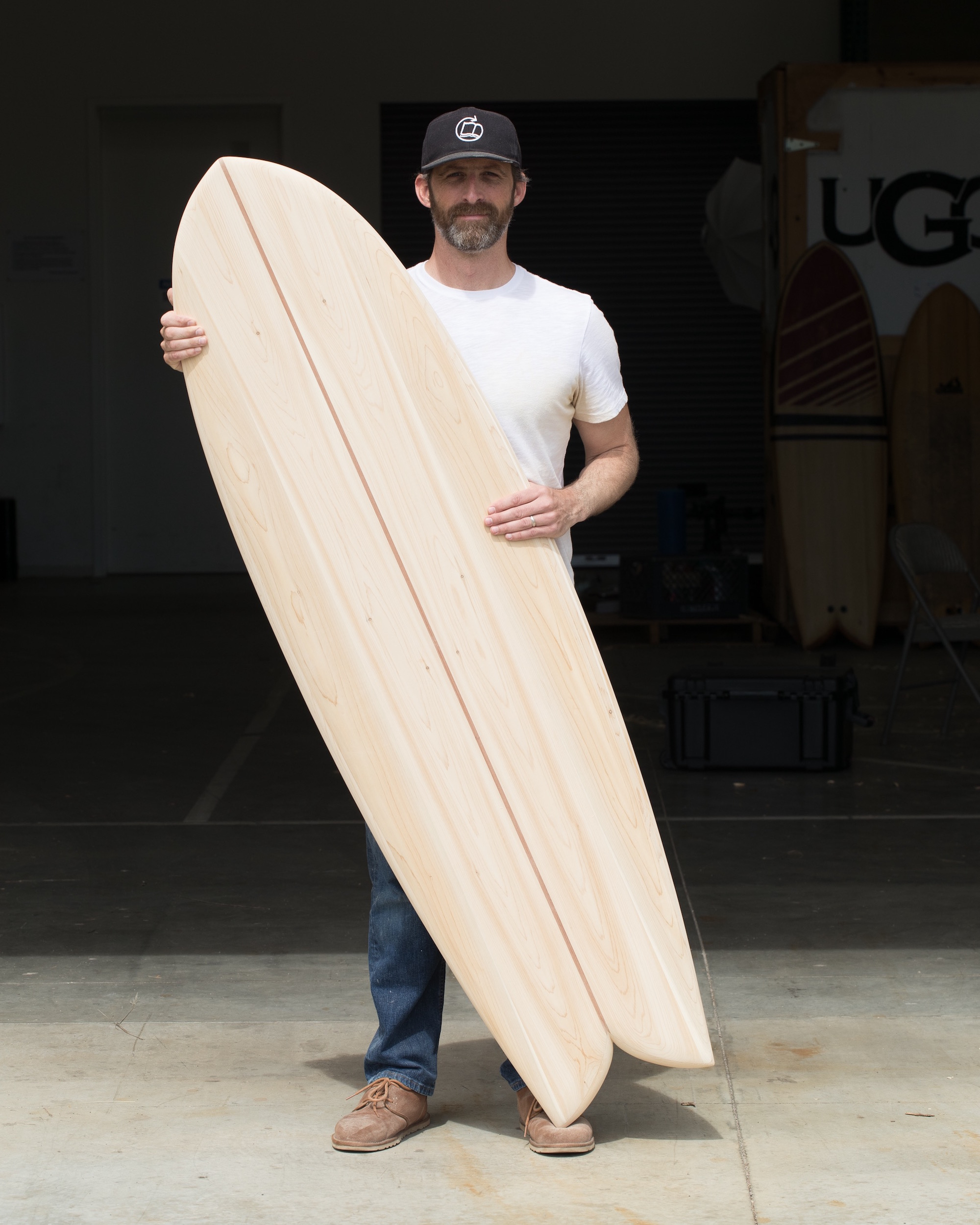 Cory proudly displays his Wherry Fish surfboard.