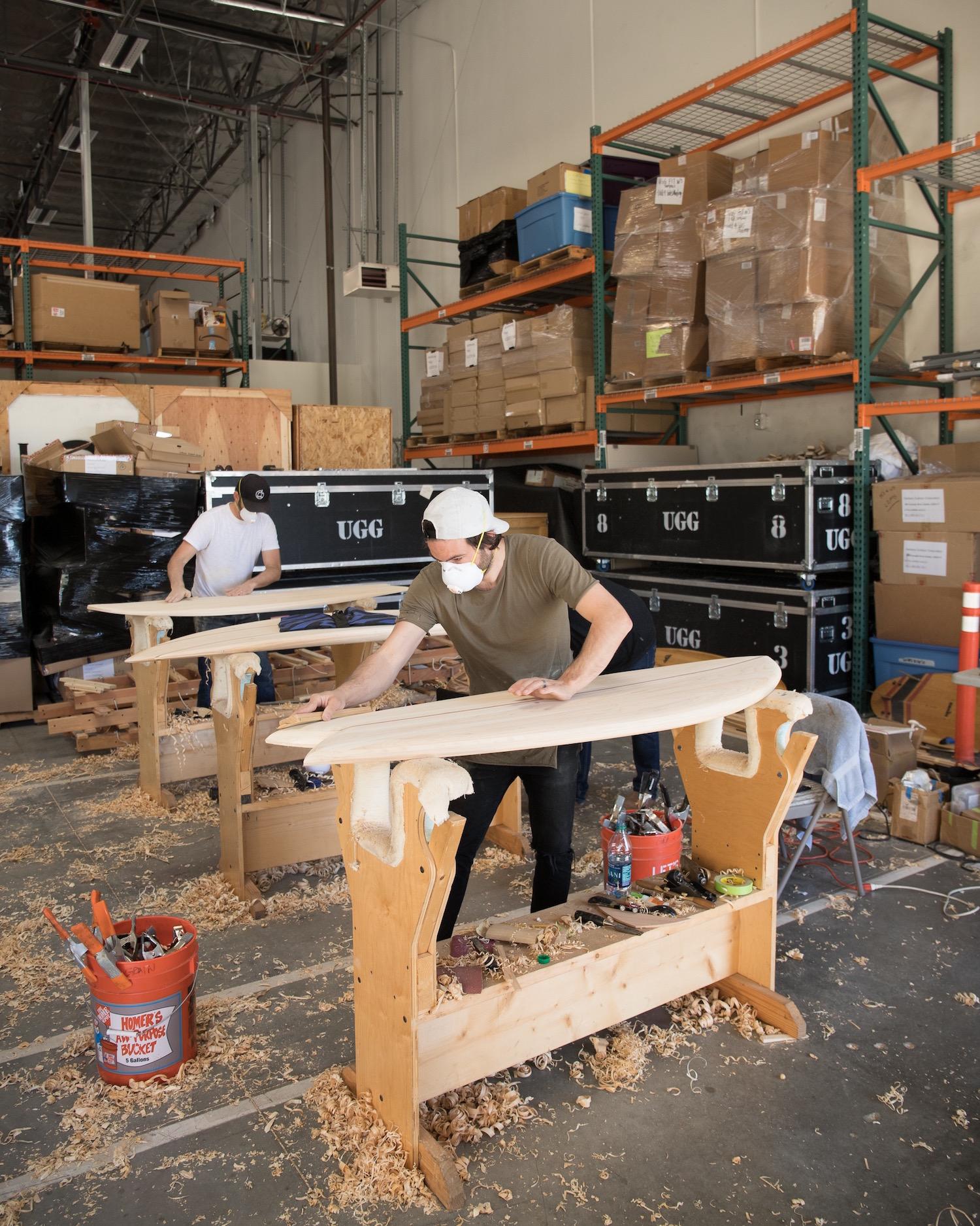 Steve Dubbeldam sands his board in the Grain workshop.