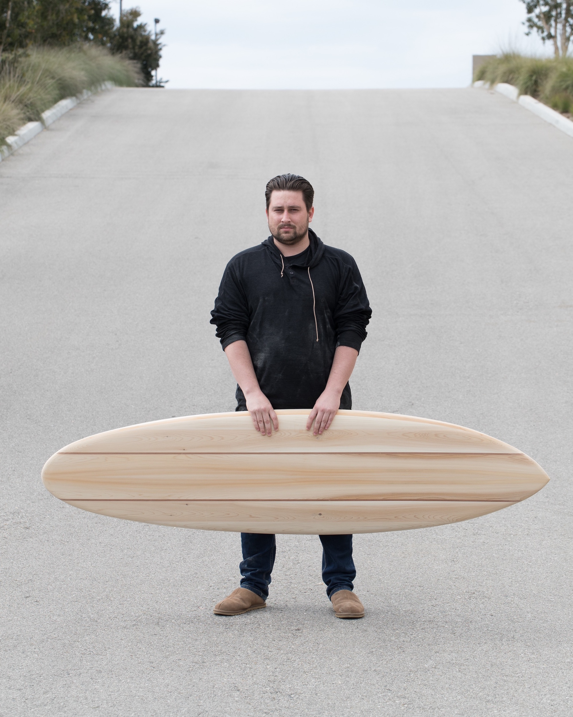 Peter poses with his Seed Singlefin surfboard.