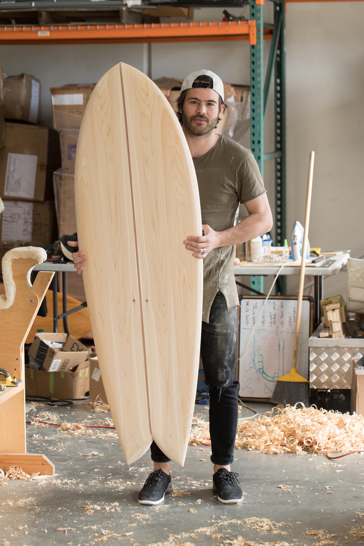 Steve shows his freshly sanded Waka Fish board.
