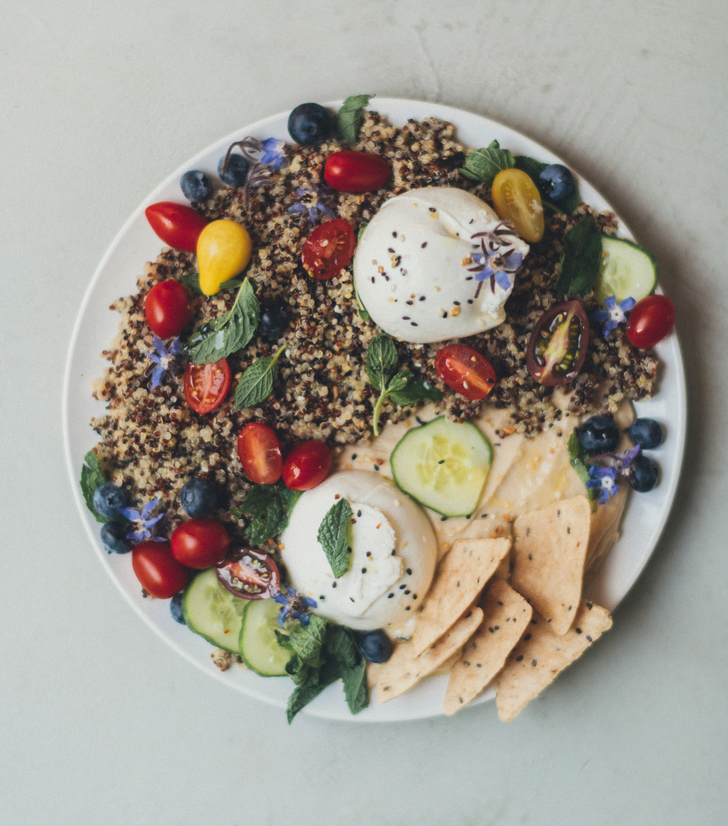Quinoa, hummus, and burrata prepared by Kara Elise