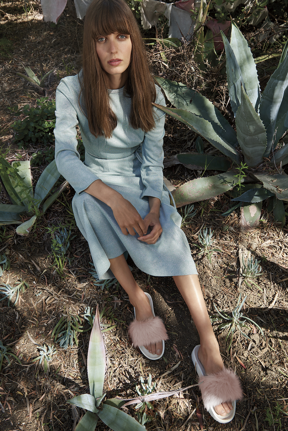 Model wears a long sleeve blue midi dress and the Royale sandal in Baby Pink