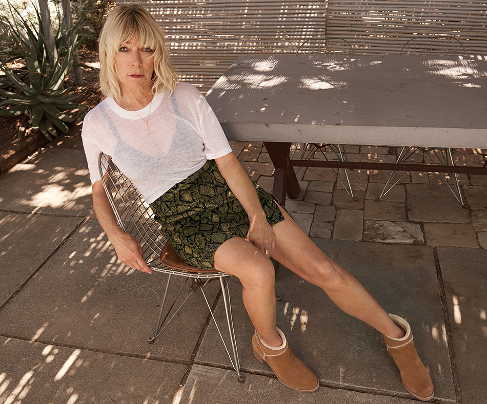 Kim Gordon sits wearing the UGG Kasen boot.