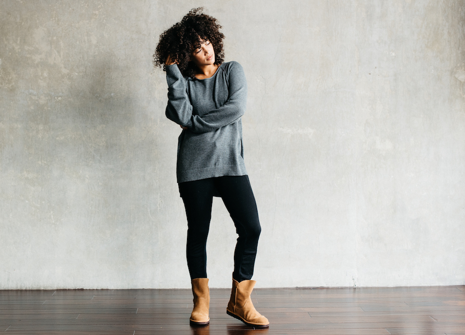 Model wears the Watts legging with a gray sweater and the Alida boot in Chestnut.